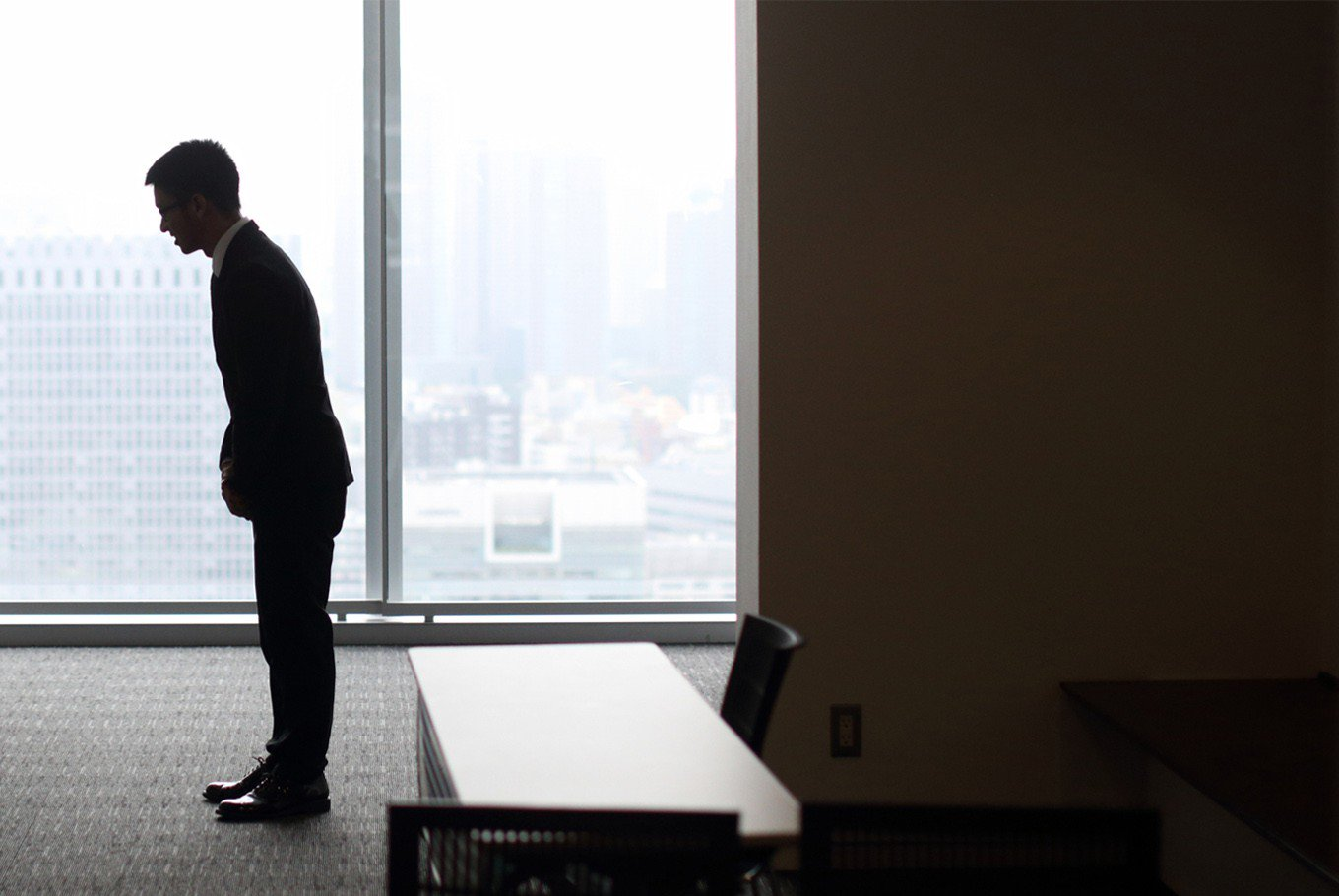 A student bows at a jobs fair in Tokyo. (Bloomberg/Tomohiro Ohsumi)